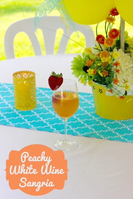 TheInspiredHome.org // Peachy White Wine Sangria. A delicious summery sangria made with Pinot Grigio, peach schnapps, raspberry sourpuss and more!