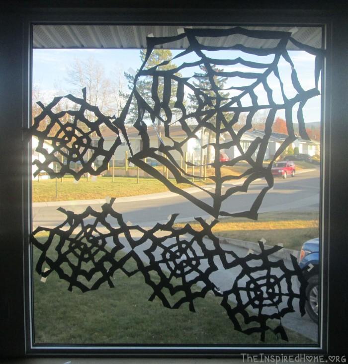 TheInspiredHome.Org // DIY Halloween Decorations // Trash Bag Spider Webs