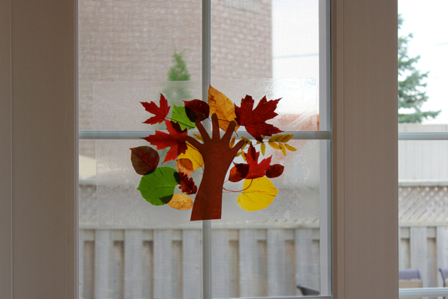 TheInspiredHome.org // Fall Leaf Craft with Toddlers. Make a stained glass tree using contact paper and a variety of autumn leaves.